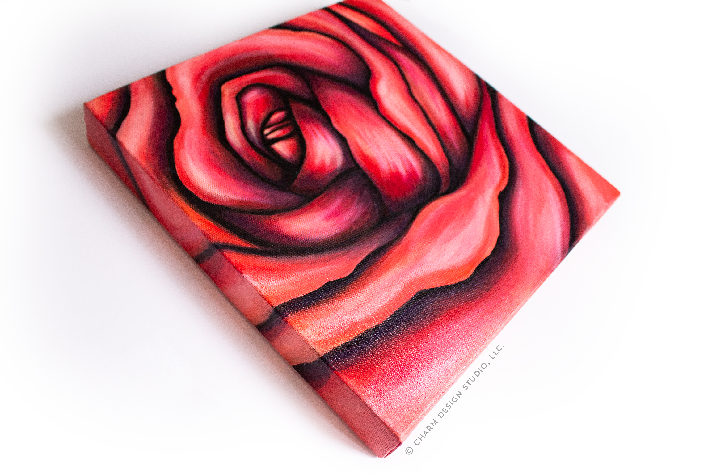 view of finished acrylic painting of a rose on canvas | image © Charm Design Studio, LLC.